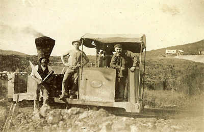 The Silverton locomotive, date not known. Note the carpenter with saw and wood plane. The mullock tip at right background may be from the Gladstone shaft